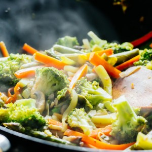 Wok stir fry with vegetables steaming