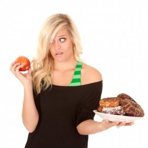woman with apple want donut