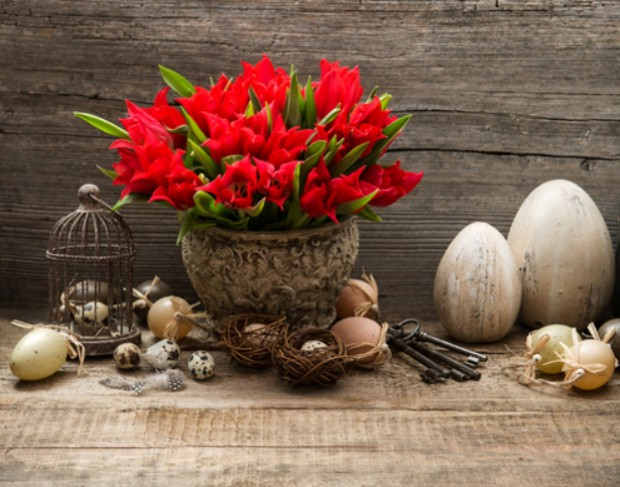 vintage easter decoration with eggs and red tulips