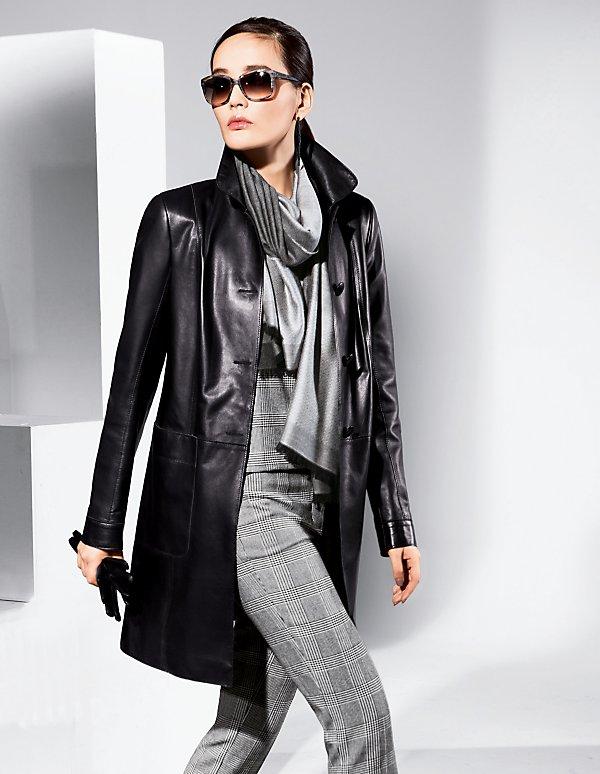 Длинная черная куртка из ягненка